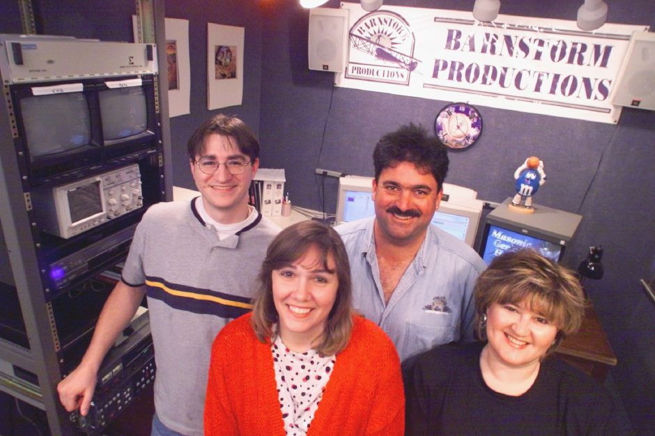 RJ file photo - The Barnstorm Productions team has recently put together marketing videos for a variety of local customers. In the foreground are business manager Donna Louise Riello, left, and sales/marketing specialist Judy Mik; in the background are editor Scott Sawala, left, and creative director and business owner Ralph Riello, May 1999.