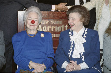 Helen Hayes, left, wears a red nose during a photo session with Patricia Neal, Monday, Oct. 21, 1991, New York. Hayes received the 1991 Arts & Business Arnold Gingrich Memorial award in recognition of her contribution to the American Theater. (AP Photo/Marcy Lederhandler)