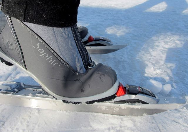 In this Jan. 20, 2018, photo, a skater shows how a Nordic skate works on Lake Morey in Fairlee, Vt., which is said to have the longest Nordic ice skating trail in the United States. (AP Photo/Lisa Rathke)