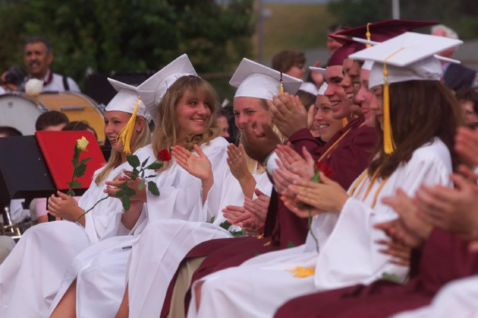 RJ file photo - At the Sheehan High School graduation ceremonies in Wallingford, a row of graduates applaud and cheer after Wallingford