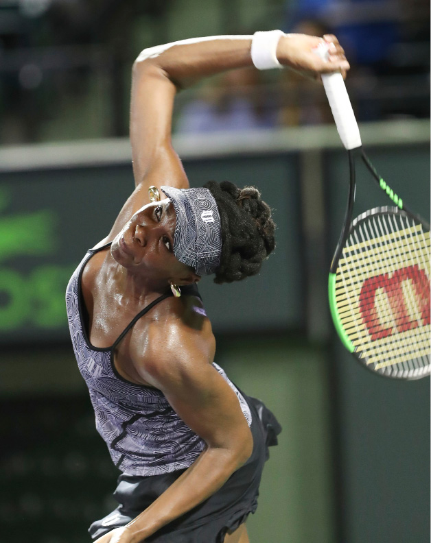 Venus Williams, of the United States, serves against Angelique Kerber, of Germany, during a quarterfinal match at the Miami Open tennis tournament, Wednesday, March 29, 2017, in Key Biscayne, Fla. Williams defeated Kerber 7-5, 6-3. (AP Photo/Mario Houben)
