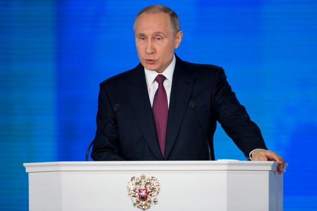Russian President Vladimir Putin gives his annual state of the nation address in Manezh in Moscow, Russia, Thursday, March 1, 2018. President Vladimir Putin set a slew of ambitious economic goals, vowing to boost living standards, improve health care and education and build modern infrastructure in a state-of-the-nation address. (AP Photo/Alexander Zemlianichenko)