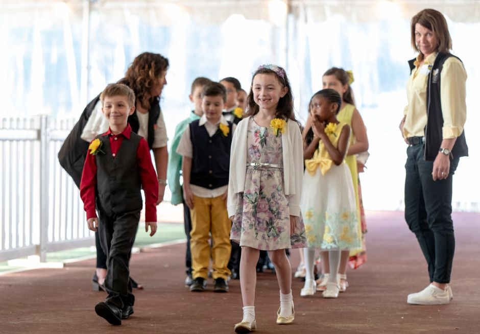 Scarlett Gibbs, 7, and Landon Harper, 8, of Ben Franklin Elementary School, are presented to the audience at the crowning ceremony for Miss Daffodil on April 24, 2019. Gibbs was selected by raffle to be crowned as the head of the Meriden Daffodil Festival. | Devin Leith-Yessian/Record-Journal