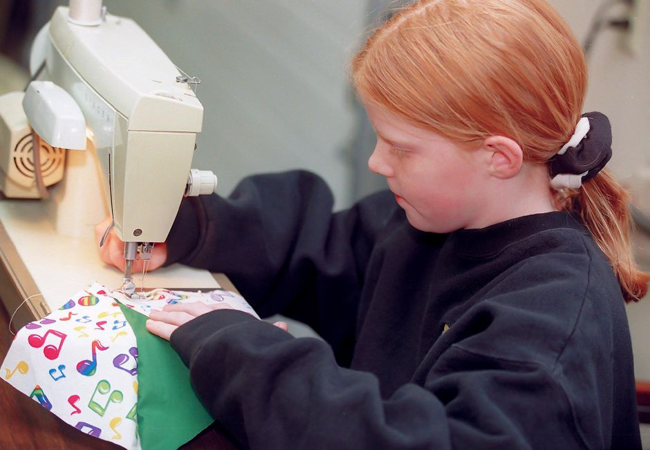 RJ file photo - Eileen Finn, 10, works on her quilt during a class at the Franciscan Life Center in Meriden, Dec. 1998.