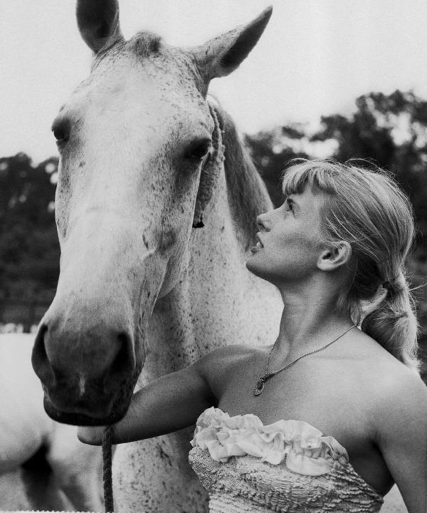 One of the trained bareback horses of Ringling Bros. Circus cocks an attentive ear as equestrienne Eva Karoly, 17, of Germany, relays the bad word that the show is ending its road tour under the big top, announced before the final shows in Pittsburgh on July 16, 1956. (AP Photo)
