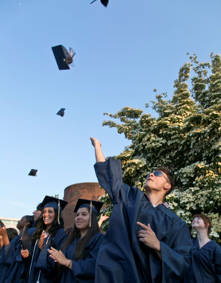 Joel Rosario tosses his cap in the air at the end of the graduation ceremony at Platt High School in Meriden, June 21, 2013. | (Christopher Zajac / Record-Journal)