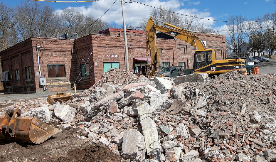 Crews continue demolition of the former Civil Defense building in front of the Spanish Community of Wallingford, Mon., Mar. 18, 2019. Dave Zajac, Record-Journal