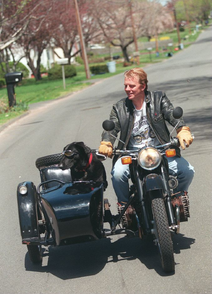 RJ file photo - Stinky rides in the sidecar attached to Gary Shamock