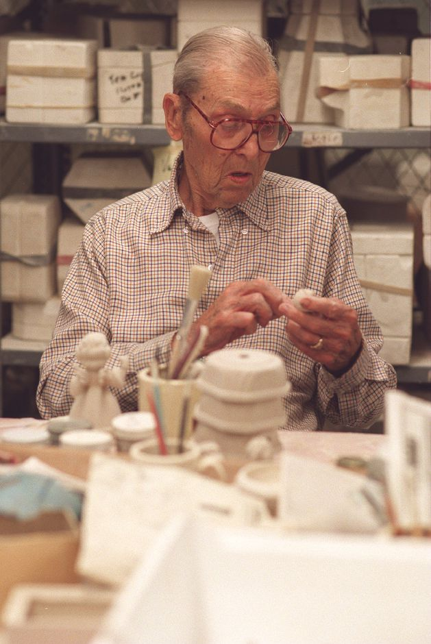 RJ file photo - Masonic Home resident Harry Oberg refines a ceramic angel figurine in the workshop, Dec. 1998.