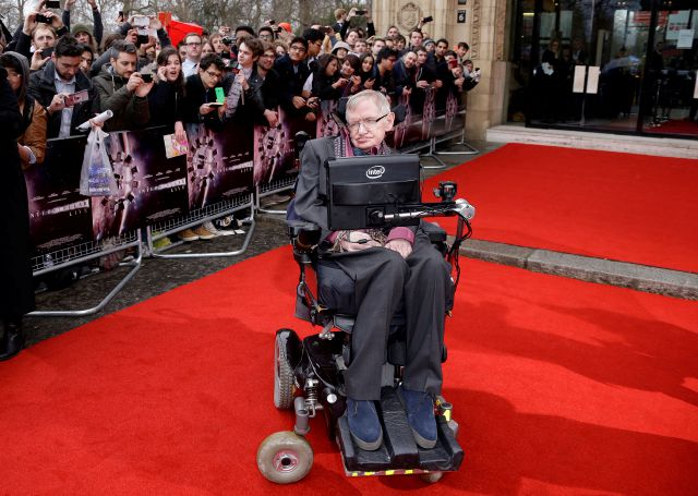 FILE - In this March 30, 2015 file photo, Professor Stephen Hawking poses for photographers upon arrival for the Interstellar Live show at the Royal Albert Hall in central London. Hawking, whose brilliant mind ranged across time and space though his body was paralyzed by disease, has died, a family spokesman said early Wednesday, March 14, 2018.(Photo by Joel Ryan/Invision/AP, File)