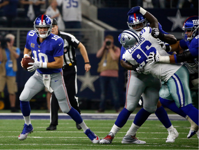 New York Giants quarterback Eli Manning (10) scrambles out of the pocket under pressure from Dallas Cowboys defensive tackle Maliek Collins (96) in the first half of an NFL football game, Sunday, Sept. 10, 2017, in Arlington, Texas. (AP Photo/Michael Ainsworth)