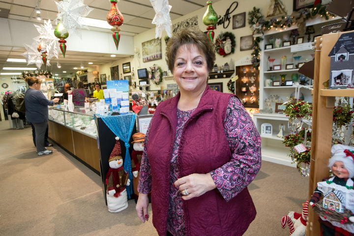 Flo Legat, owner of Just for You Gift Shoppe, stands welcoming shoppers on small business Saturday in Southington in November 2015.| File photo, Record-Journal
