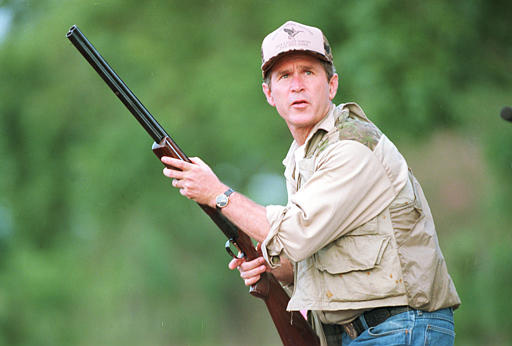 "George W. Bush looks to the sky during a dove hunt Sept. 1, 1994, in Hockley, Texas during his first Texas gubernatorial campaign. Anticipating some dove hunting on a 100-plus degree day during Sept. 2000, Bush explained that the birds could be marinated, but ""I"
