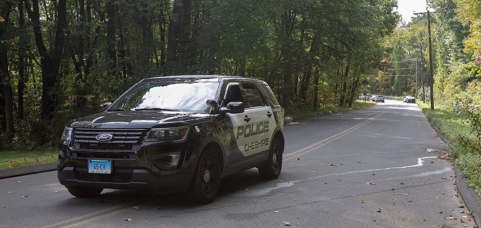 Cheshire police close a section of Marion Avenue in Cheshire after a missing person was found dead near the intersection of Mixville and Marion roads, Thursday, Oct. 4, 2018. | Dave Zajac, Record-Journal
