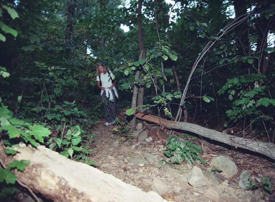 Donna Porstner finds her way still in daylight but still quite dim in the forest near Ragged Mountain Aug. 10, 1999.
