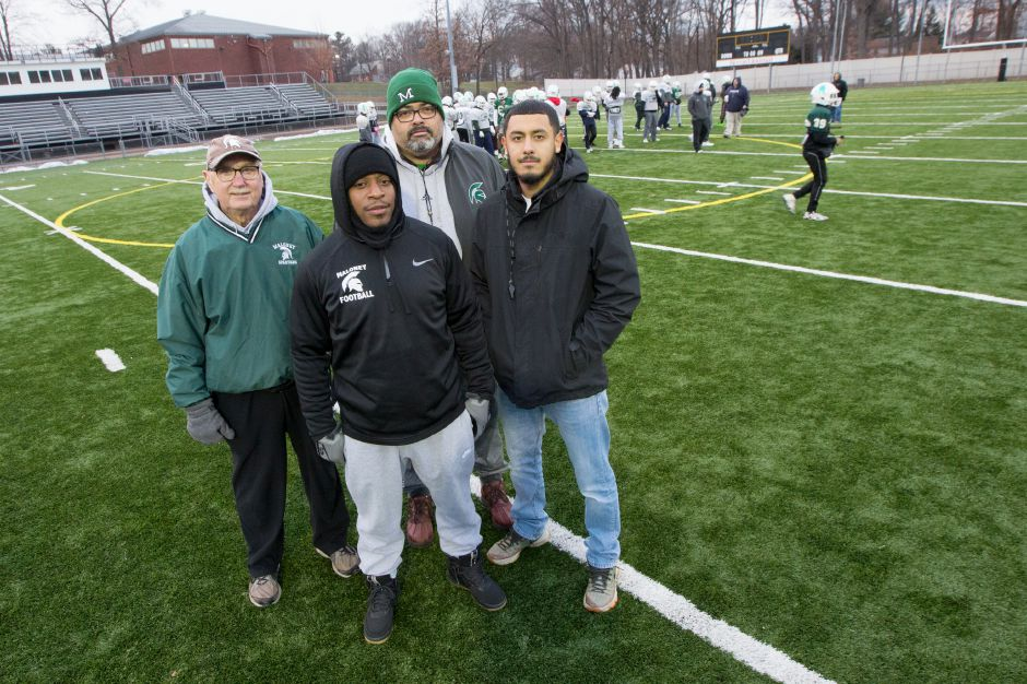 Some of the Maloney coaches with state championship game experience, either as players or coaches, are, from left, Mike Falis, Jamel Riddle, Carlos Pina and Kevin Ruiz.