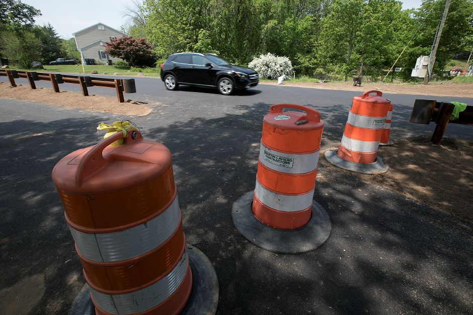 A motorist travels through the intersection of Hart and Curtiss Streets in Southington, Friday, May 25, 2018. Dave Zajac, Record-Journal