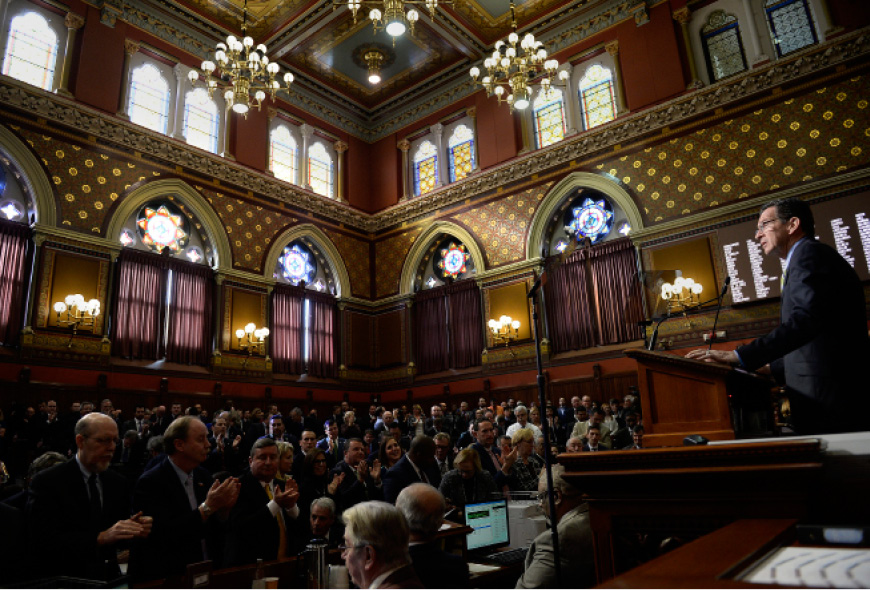 FILE PHOTO: Connecticut Gov. Dannel P. Malloy delivers his budget address to members of the house and senate inside the Hall of the House at the state Capitol in Hartford, Conn., Wednesday, Feb. 8, 2017. (AP Photo/Jessica Hill)