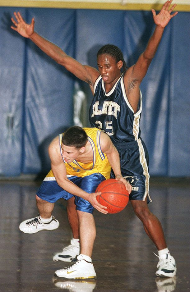 RJ file photo -Wayne Rivera and Wilcox Tech hit a highly mobile stone wall in their season opener against Jermaine Fordham and Platt, Dec. 18, 1998.