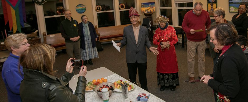 Sujitno Sajuti, center, thanks supporters while celebrating his 69th birthday at the Unitarian Universalist Church on Paddock Avenue in Meriden, Wednesday, Dec. 13, 2017. Sajuti, an undocumented West Hartford resident, has taken up sanctuary at the Unitarian Universalist Church. Dave Zajac, Record-Journal