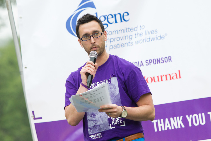 Bobby Nims Media coordinator welcomes runners and walkers Saturday during the PurpleStride 5k and walk fundraiser for Pancreatic Cancer Action Network at Hubbard Park in Meriden Jun. 17, 2017 | Justin Weekes / For the Record-Journal