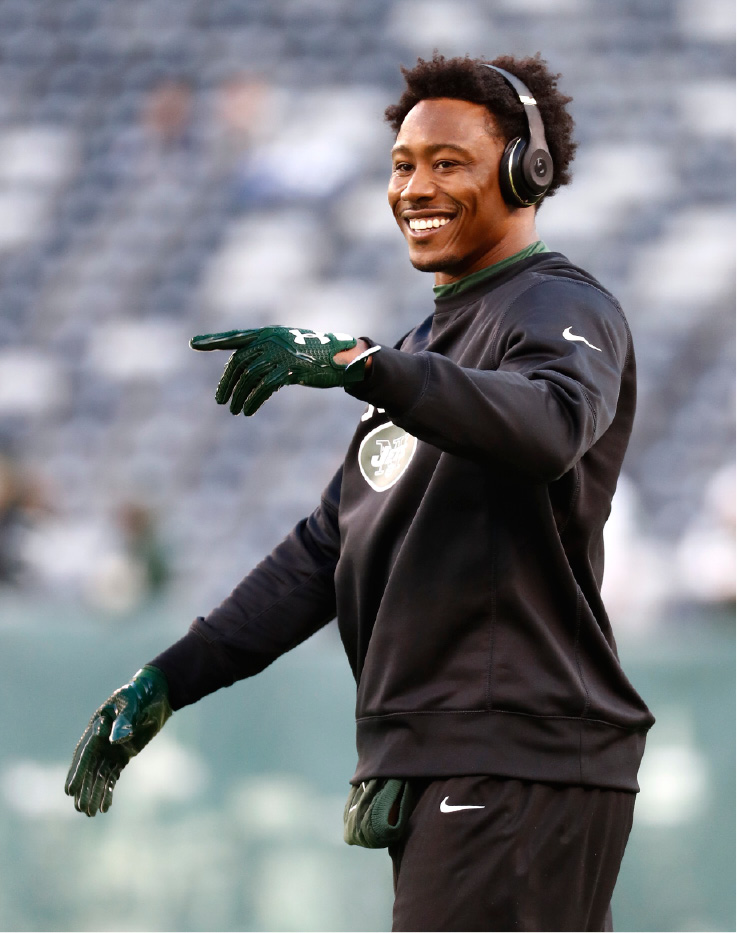 FILE - In this Nov. 27, 2016, file photo, New York Jets wide receiver Brandon Marshall (15) warms up before playing against the New England Patriots in an NFL football game in East Rutherford, N.J. The New York Giants have signed free agent receiver Brandon Marshall to a two-year contact. The former Jets receiver tweeted a picture of the signed contact on Wednesday, March 8, 2017.  (AP Photo/Julio Cortez, File)