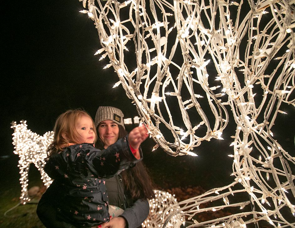 Sarah Pelletier and her daughter, Hayden, 2, of Prospect, look over a lighted horse display during the annual Festival of Silver Lights at Hubbard Park in Meriden on Tuesday.