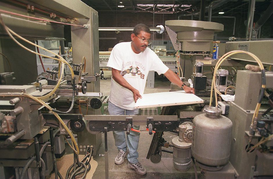 RJ file photo - Osvaldo Lopes, of Waterbury, calibrates a dowelling machine at the LesCare Kitchen Inc. plant in Southington, Sept. 1998.