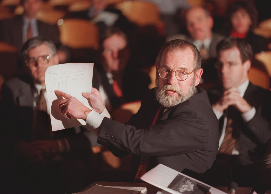 RJ file photo - Kenneth P. Roberts, chief operating officer of Power Development Co., answers Siting Council questions by pointing to a diagram during a hearing at Platt High School in Meriden Jan. 25, 1999.