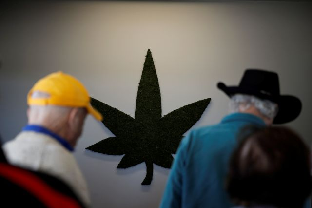 In this Feb. 19, 2019 photo, a group of seniors from Laguna Woods Village check in at Bud and Bloom cannabis dispensary in Santa Ana, Calif. More Americans in their 70s and 80s are adding marijuana use to their roster of senior activities. Recent studies show that people 65 and over are the fastest-growing segment of cannabis users. (AP Photo/Jae C. Hong)