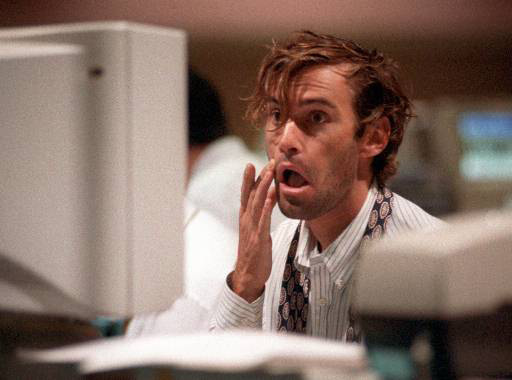 Trader Todd Robinson watches a monitor on the floor of Pacific Stock Exchange in Los Angeles shortly after market opening early Tuesday morning, Sept.1, 1998. A jittery Wall Street tried to come back from Monday