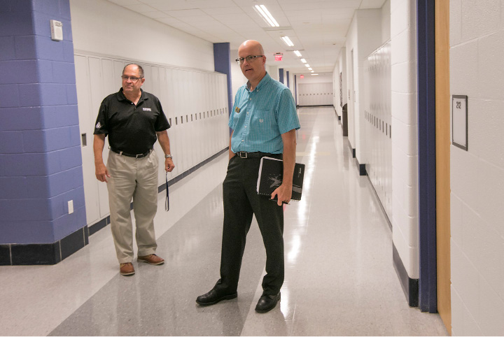Platt High School Principal Robert Montemurro, left, and Steve Minkler, academic dean and interim president of Middlesex Community College, confer near classrooms that will be used by Middlesex Community College students at Platt High School, Thursday, August 17, 2017.  | Dave Zajac, Record-Journal