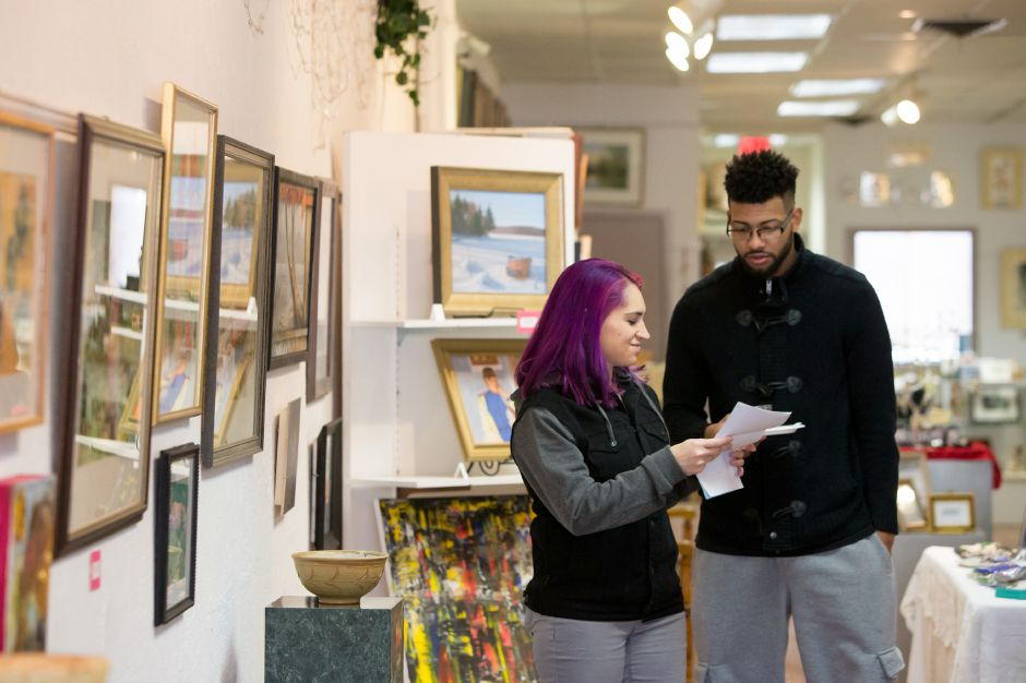 Tamsin Gosselin of Meriden left talks with friend Miguel Almonte of New Britain Saturday during Gallery 53