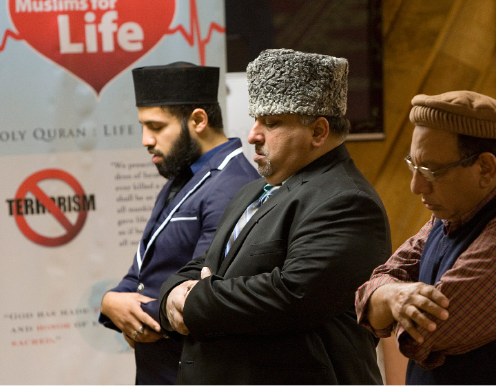 FILE PHOTO: Members of the Ahmadiyya Muslim Community, left to right, Zahir Mannan, Mohammed Qureshi, state chapter president, and Raza Ahmad pray during a service at the Baitul Aman Mosque in South Meriden, Friday, Dec. 18, 2015. |  Dave Zajac / Record-Journal