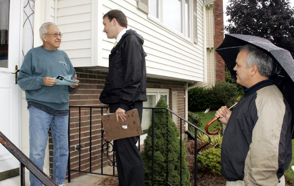 Chris Murphy, center, chats with Higby Drive resident Jimmy Campanna with David Salafia, right, on a wet Thurs. night, Sept. 14 as he was going door-to-door.