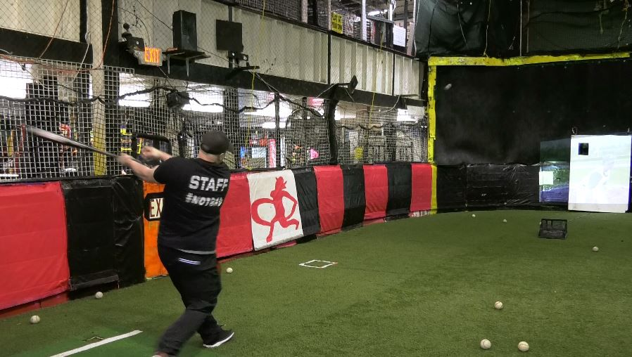 Above: Paul Cambra, owner of Ultimate Sports & Party Center at 120 Church St., Yalesville, practices hits Friday in the virtual batting cage area. Below: A glow-in-the-dark party. For more photos, visit  us online at www.myrecordjournal.com.