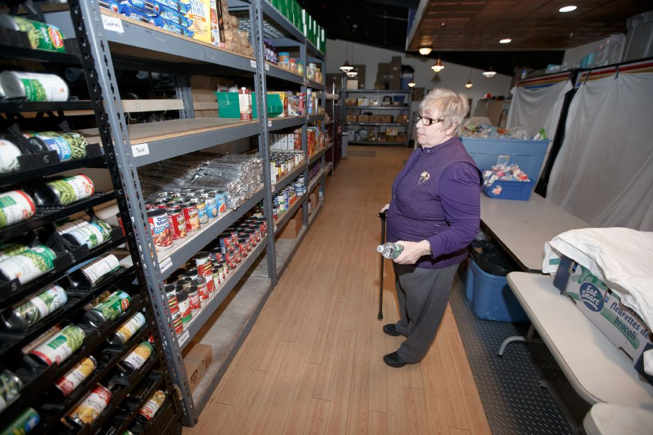 Gail Powell Board Chair check the inventory of canned goods Monday at Masters Manna in Wallingford February 19, 2018 | Justin Weekes / Special to the Record-Journal