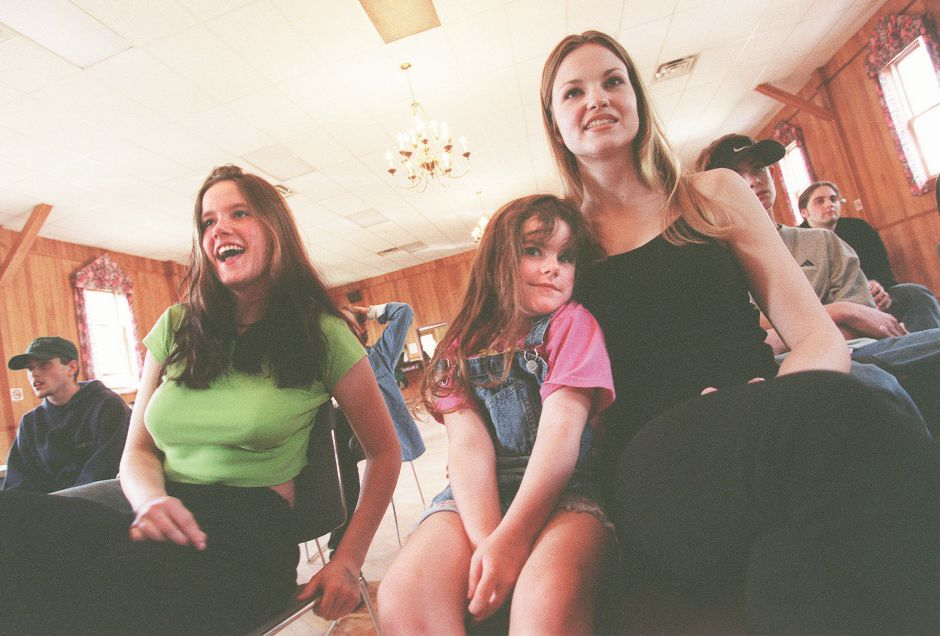 RJ file photo - From left, Jodi Boykin, 16, of Meriden, her cousin Amber Boykin, and their pal Jodie Lynn, 21, of New York, enjoy the music of Recovering Catholics at the Music Marathon tribute to Richard Lee May 3, 1998.
