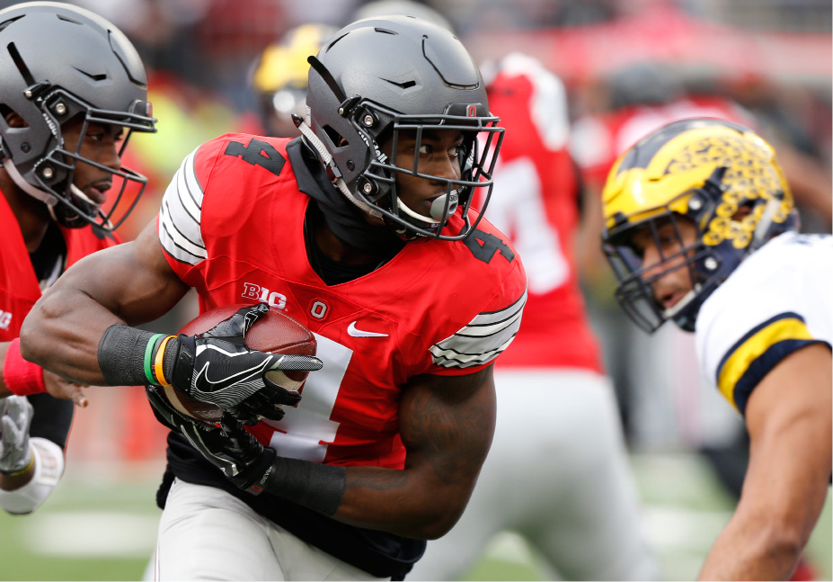 FILE - In this Saturday, Nov. 26, 2016, file photo, Ohio State running back Curtis Samuel runs the ball against Michigan during the first half of an NCAA college football game in Columbus, Ohio. Ohio State didn