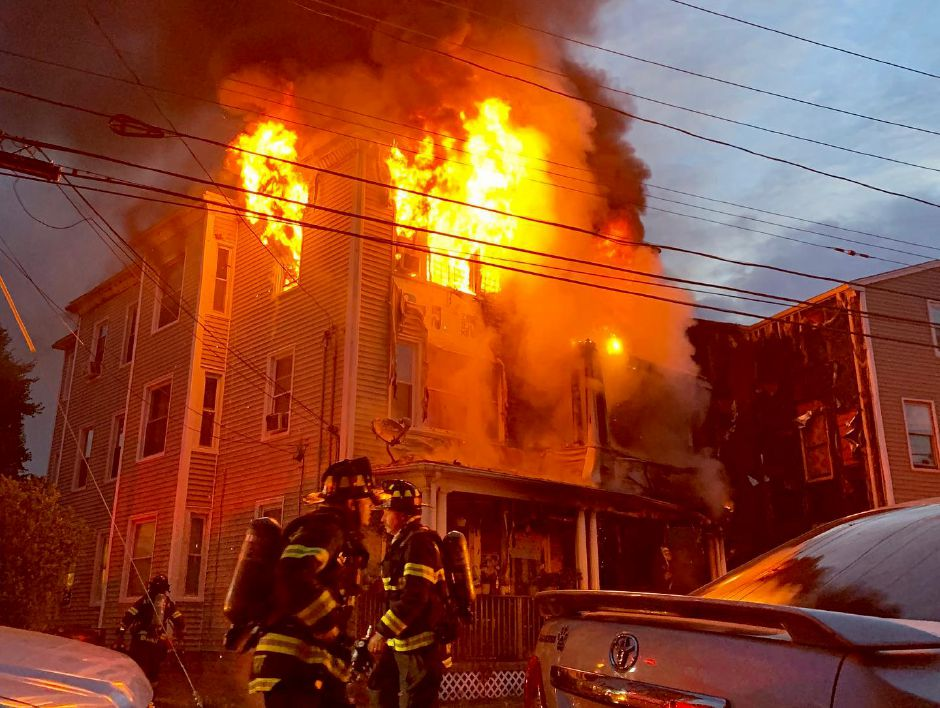 Meriden firefighters battle a large blaze at 144 Miller St. early Wednesday morning July 17, 2019. | Courtesy of Matt Van Ness