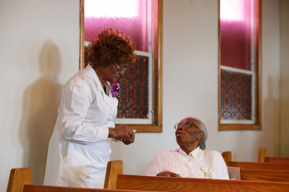 Sister Rhudean Raye left talks with Sister Eloise Hawkins of New Haven Sunday during the Combined Ushers Anniversary at Parker Memorial AME Zion Church in Meriden. Ushers were honored from across the state. March 4, 2018 | Justin Weekes / Special to the Record-Journal
