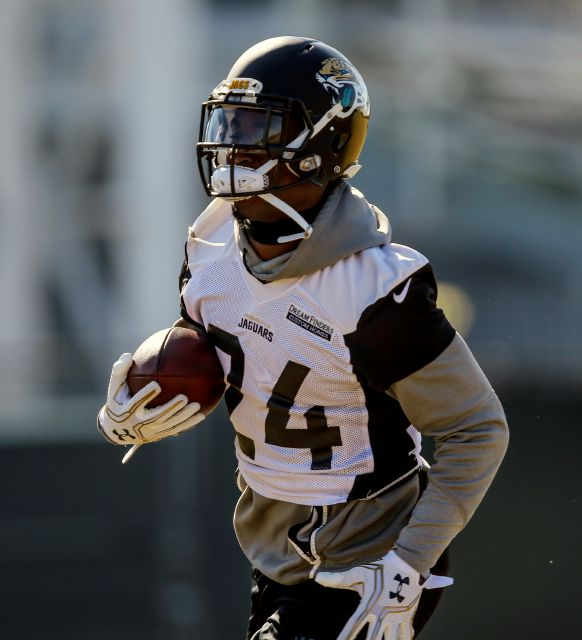 FILE - In this Jan. 19, 2018 file photo, Jacksonville Jaguars running back T.J. Yeldon (24) runs with the ball during an NFL football practice in Jacksonville, Fla. Yeldon hasn
