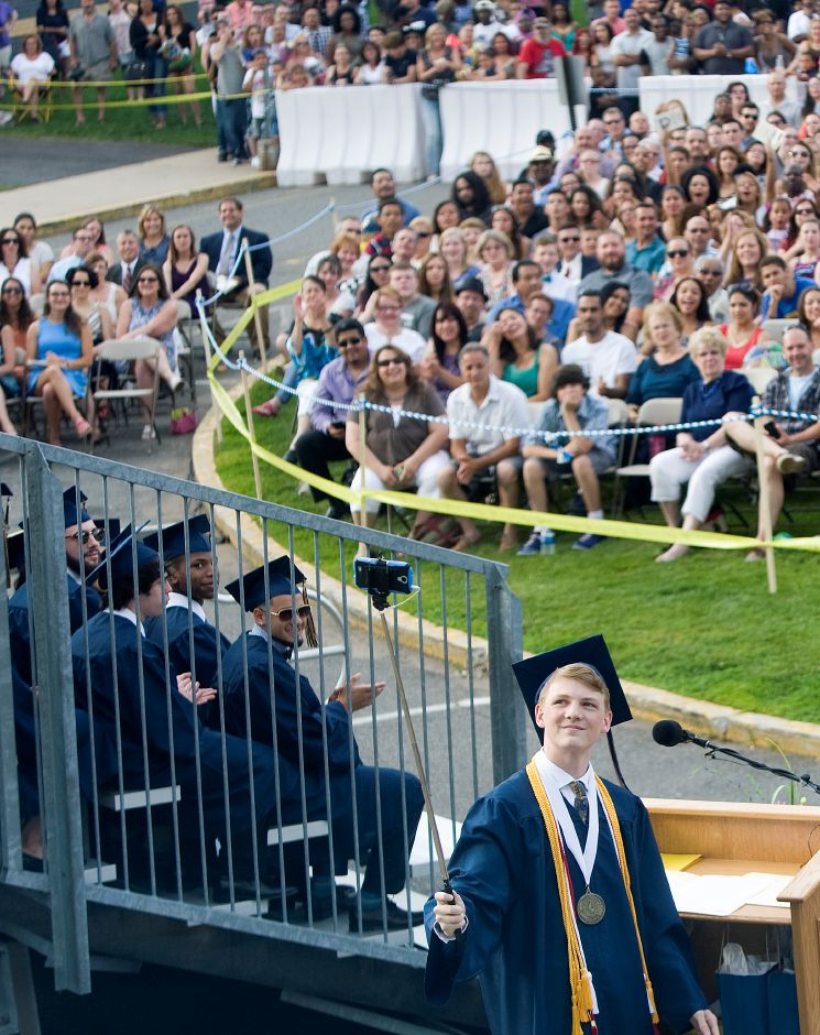 "Wesley Schlett, class of 2015 president, manages a ""selfie"" before his speech during graduation ceremonies at Platt High School in Meriden, Friday, June 19, 2015. 