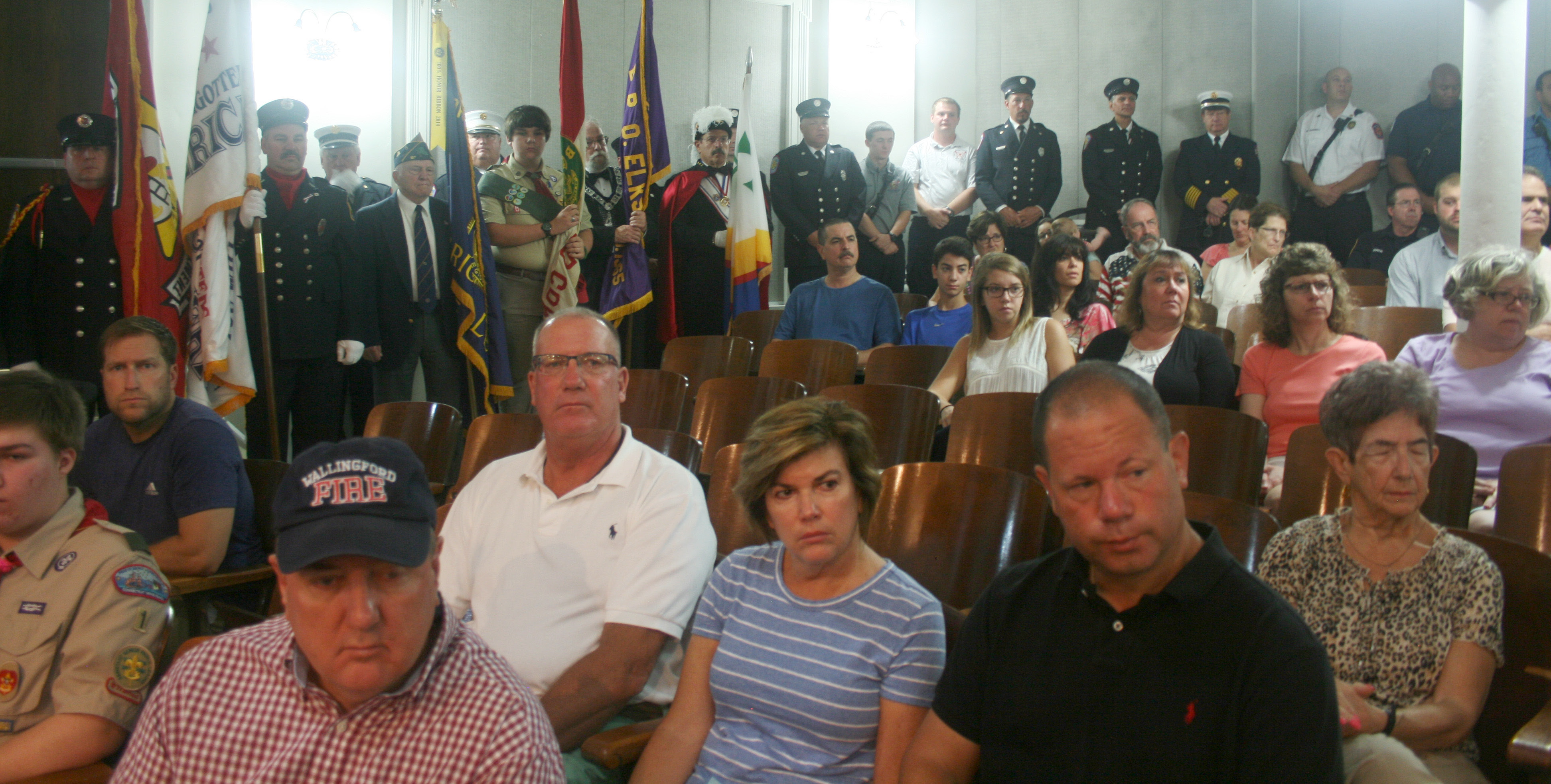 Members of the Wallingford Fire Department, Wallingford Police Department, veterans and fraternal groups and Boy Scout Troop 1 lined the walls of the town council chambers at the 9/11 remembrance ceremony Sunday at the Wallingford Town Hall.  | Lauren Takores, Record-Journal