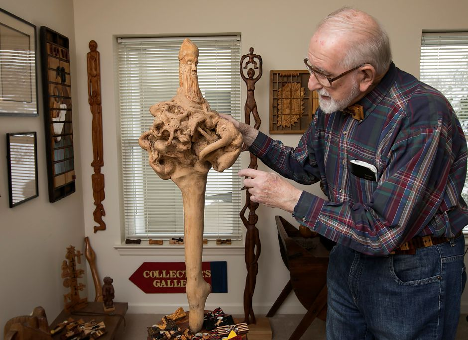 Marv Beloff, of Wallingford, founder of the International Wooden Bow Tie Club, points out the details of his carving,