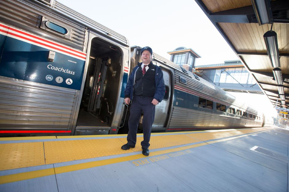 Conductor Conway waits for passengers on platform 1 Friday at the Meriden Train Station in Meriden November 24, 2017 | Justin Weekes / For the Record-Journal