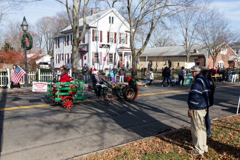 Doug Decosta drives his 1925 Century tractor Saturday during Christmas in the Village on Main Street in South Meriden December 1, 2018 | Justin Weekes / Special to the Record-Journal
