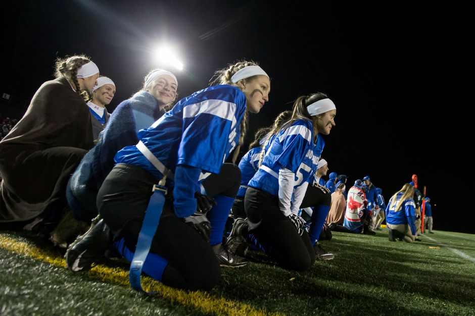 Southington takes a knee after a New Britain injury Wednesday during the 9th Annual Powder Puff football game at Veterans Memorial Stadium in New Britain. Southington defeated New Britain 20 to 0 to make it two wins in a row. November 22, 2017 | Justin Weekes / For the Record-Journal