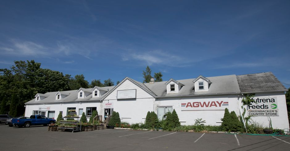 Agway, right, and A&A Restaurant, left, on Murdock Avenue in Meriden, Tuesday, June 26, 2018. The Greenbacker family property is for sale. Dave Zajac, Record-Journal