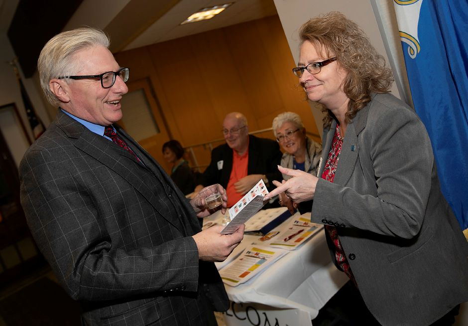 "Bob Carr, vice president of sales for Premiere Printing and Mailing Solutions, talks with Rosanne Ford, vice president of membership services for the Midstate Chamber of Commerce, during the 2nd Annual Record-Journal 4-Chamber Social ""Casino Night,"" at the Record-Journal on Broad Street in Meriden, Wed., Nov. 14, 2018. Dave Zajac, Record-Journal DAVE ZAJAC"